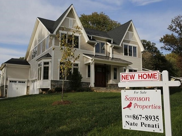 A real estate sign advertising a new home for sale is pictured in Vienna, Virginia, US. File Photo