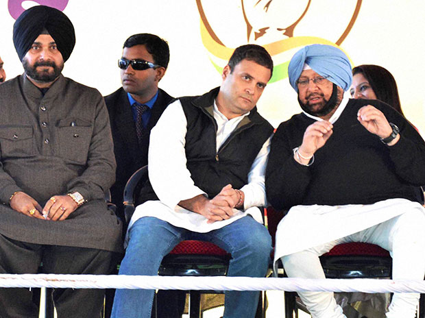 Congress Vice President Rahul Gandhi with party leaders Navjot Singh Sidhu and Captain Amarinder Singh during a rally in Majitha. Photo: PTI