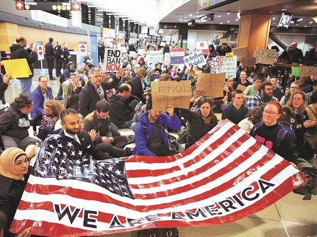 Demonstrators at the concourse of the Seattle-Tacoma International Airport where more than 1,000 people gathered on Saturday to protest the order restricting immigrants' entry to the US (Photo: AP/PTI)