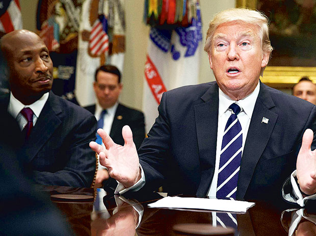 Merck CEO Kenneth Frazier (left) listens as President Donald Trump speaks during a meeting with pharmaceutical industry leaders in the Roosevelt Room of the White House in Washington on Tuesday. 	(Photo: AP/PTI)