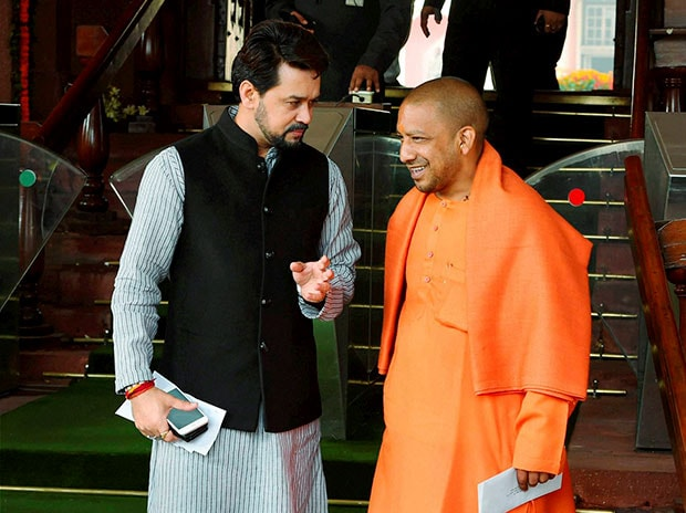 BJP MPs Anurag Thakur and Yofgi Adityanath. Photo: PTI