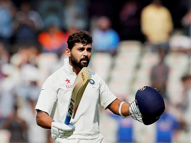 India's Murali Vijay raises his bat and helmet to celebrate scoring a century during the first day of the test match against Bangladesh in Hyderabad on Thursday. PTI Photo