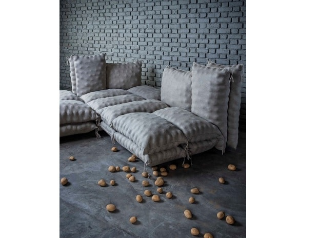 AlooBori Sofa subverts the idea of the couch potato and presents itself as an installation of soft foam-filled jute sacks meant for sitting and is deceptively comfortable.