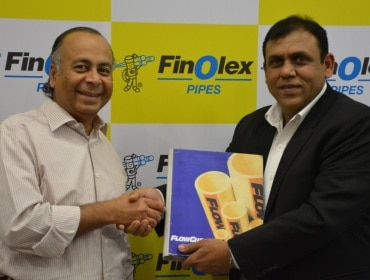 Prakash Chhabria (left) of Finolex Industries with Lubrizol India's Manish Jain