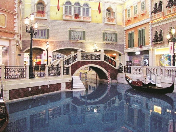 A Venetian canal; (below left) Portuguese architecture alongside Chinese neonlights  Photos: Gaurav Sharma