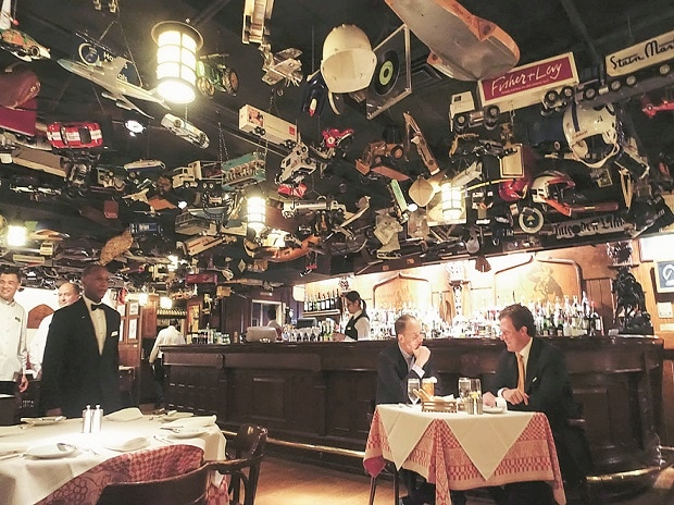 The ceiling at 21 Club is adorned with memorabilia donated by regulars