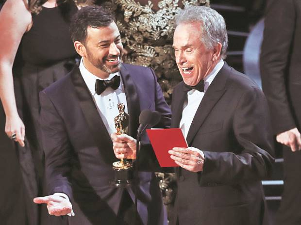 Jordan Horowitz, producer of La La Land, shows the envelope revealing 'Moonlight' as the true winner of Best Picture at the Oscars on Sunday. Photo: Reuters