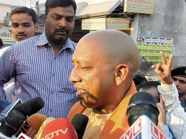 BJP MP Yogi Adityanath interacts with media after casting his vote during the sixth phase of the state assembly election in Gorakhpur on Saturday. Photo: PTI