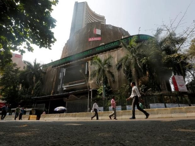People walk past the Bombay Stock Exchange (BSE) ...