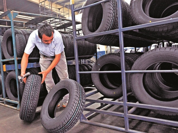 Tyre stocks up as rubber prices fall | Business Standard News
