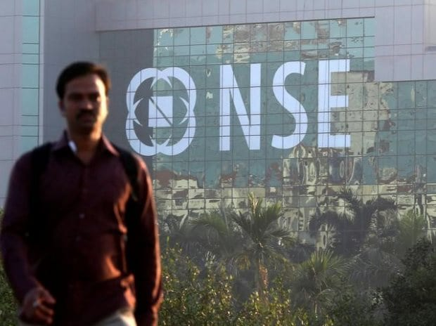 A man walks past the NSE (National Stock ...