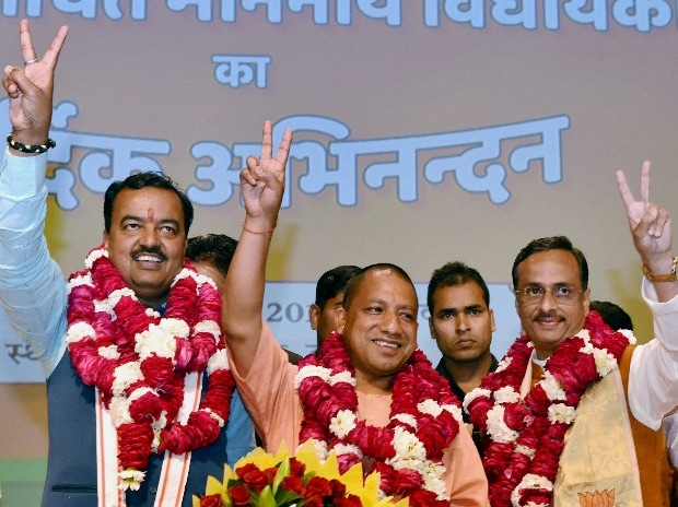 BJP's  Yogi Adityanath (C) elected leader of the BJP Legislature Party (Chief Minister Uttar Pradesh)  K P Muriya (L Deputy CM) and Dinesh Sharma (R Deputy CM) showing victory sign after the meeting in Lucknow