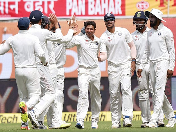 Kuldeep Yadav celebrates after taking the wicket of Glenn Maxwell of Australia during the first day of last Test match at HPCA Stadium in Dharamsala. Photo: PTI