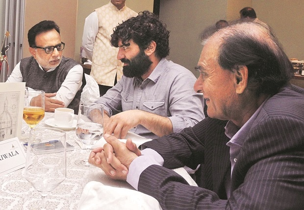 (From left) Revenue Secretary Hasmukh Adhia interacts with Eicher CEO Siddhartha Lal and Marico chief Harsh Mariwala