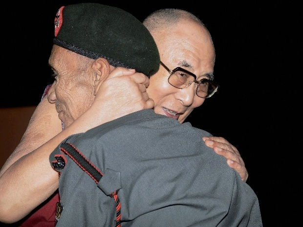 Tibetan spiritual leader Dalai Lama with Naren Chandra Das, a retired havildar of 5 Assam Rifles during Namami Brahmaputra festival in Guwahati on Sunday. Das is a lone survivor of the seven Indian personnel who received Dalai Lama on the Indian soil