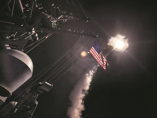 A US Navy guided-missile destroyer conducts strike ops against Syria on Friday. Photo: Reuters