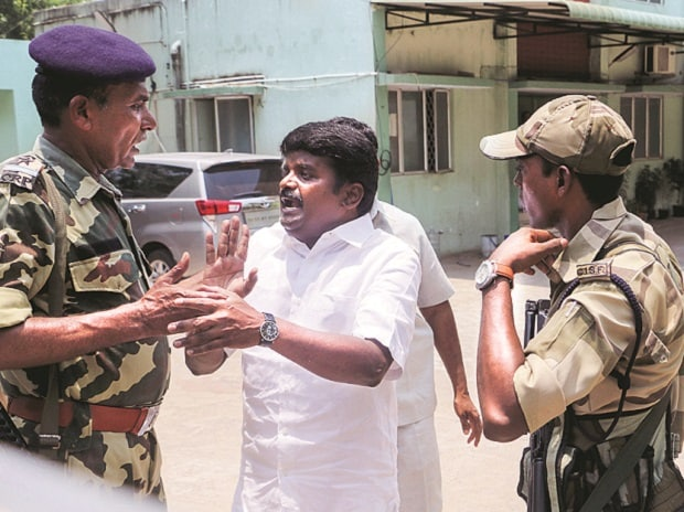 Tamil Nadu Health Minister Vijaya Baskar in an argument with the CRPF personnel during a raid at his residence by the income tax department in Chennai on Friday. Photo: PTI