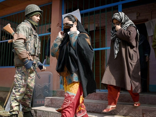 Women coming out from a polling station after casting their vote in Srinagar on Sunday. Photo: PTI