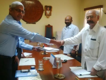 Andhra Sugars & Thyssenkrupp Industrial Solutions officials signing the contract