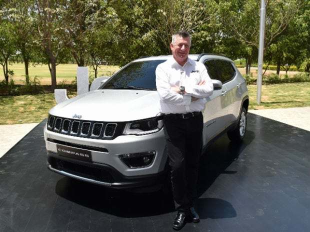 Kevin Flynn President and Manging Director FCA India with the Made-in India Jeep Compass