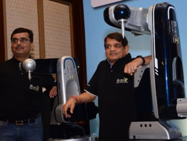 TAL Manufacturing officials with TAL Brabo robot