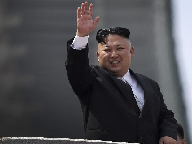 North Korean leader Kim Jong Un waves during a military parade on Saturday