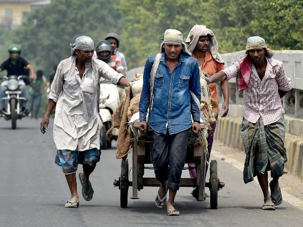 Labourers transport meterials on a hand cart on a hot summer day in New Delhi (Photo: PTI)