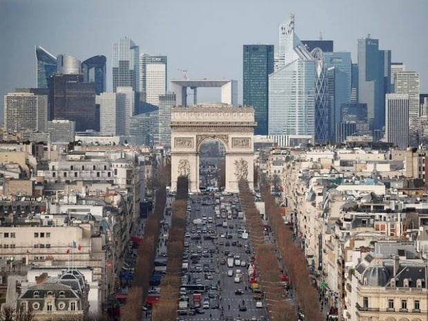 General view of the skyline of La Defense business district with its Arche behind Paris' landmark, the Arc de Triomphe and the Champs Elysees Avenue in Paris, France