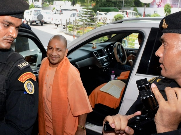 UP Chief Minister Yogi Adityanath arrives at his office without red becon vehicle in lucknow. File photo