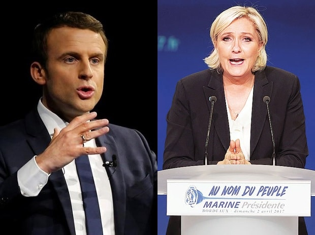 Centrist Emmanuel Macron (left) and far-right leader Marine Le Pen to fight in second round of French Presidential elections