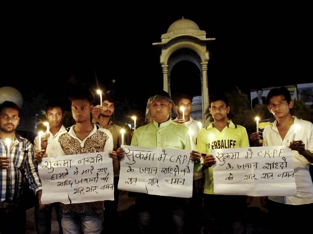 LJP activists take part in a candle light vigil to pray for CRPF jawans lost their lives in a Naxal attack in Chhattisgarh's Sukma district
