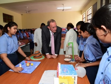 Richard Northcote (centre), CSO, Covestro AG, interacting with  students at the mini science centre