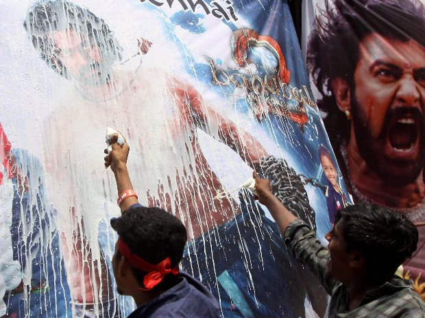 """Fans pour milk on a giant poster of """"Bahubali 2: ..."""