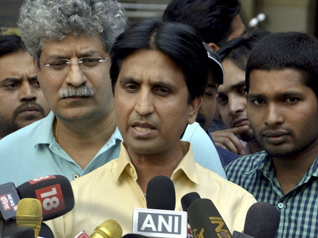 AAP leader Kumar Vishwas speaks to media at his residence in Ghaziabad