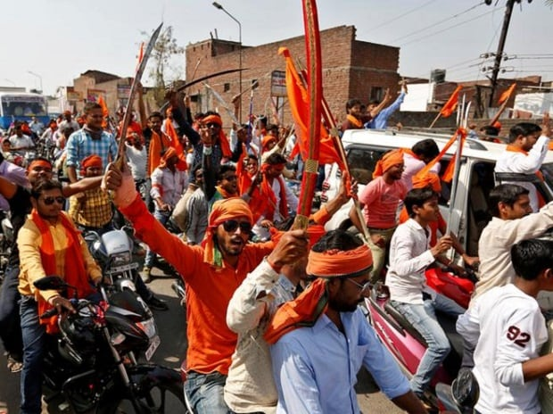 REBELS WITH A CAUSE: Hindu Yuva Vahini vigilante members take part in a rally in Unnao, Uttar Pradesh. Photo: Reuters