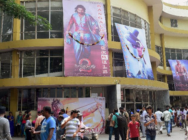 Movie fans at a theatre in Bengaluru to watch the