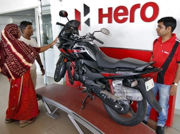 Customers at a Hero MotoCorp showroom in Ahmedabad. Photo: Reuters