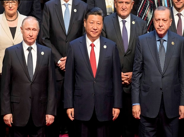 Chinese President Xi Jinping, Russian President Vladimir Putin, Turkish President Recep Tayyip Erdogan pose for a group photo at opening ceremony of the Belt and Road Forum the China National Convention Center in Beijing. Photo: PTI