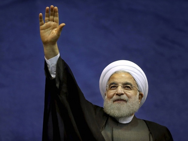 Iranian President Hassan Rouhani waves to his supporters upon arrival in a campaign rally for May 19 presidential election in Tehran, Iran, Saturday, May 13, 2017. Photo: PTI