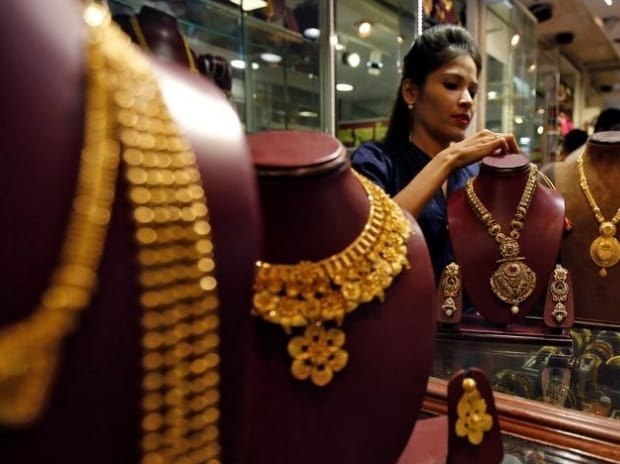 A salesperson attends to a customer (not pictured) inside a jewellery showroom, during Akshaya Tritiya, a major gold-buying festival, in Mumbai