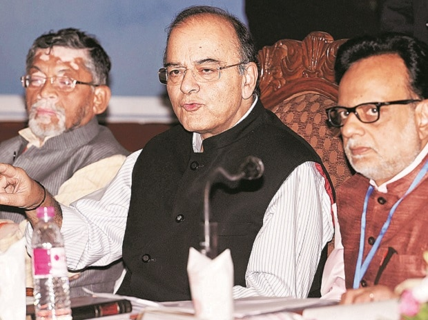 Union Finance Minister Arun Jaitley (centre) with MoS Santosh Gangwar (left) and Revenue Secretary Hasmukh Adhia at a press conference on the first day of the 14th Goods and Services Tax (GST) Council at SKICC in Srinagar on Thursday. Photo: PTI