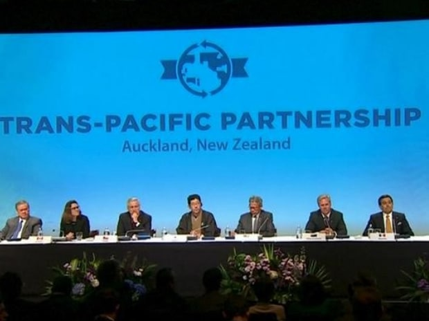 Trade ministers and officials from the 12 Trans-Pacific Partnership (TPP) member nations are seen at the signing ceremony in Auckland, New Zealand in this still frame taken from video on February