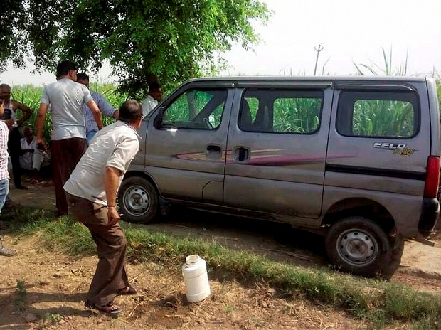 Police investigates near the vehicle, in which seven members of family along with a driver were travelling while being attacked by a group of at least five criminals on Jewar-Bulandshahr road off Yamuna Expressway. Photo: PTI