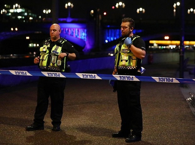 Police at the site where pedestrians were moved by a van in the London Bridge area