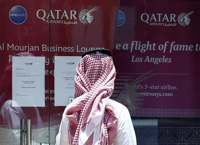 A man stands outside Qatar Airways office in Riyadh, Saudi Arabia, June 5, 2017. Photo: Reuters