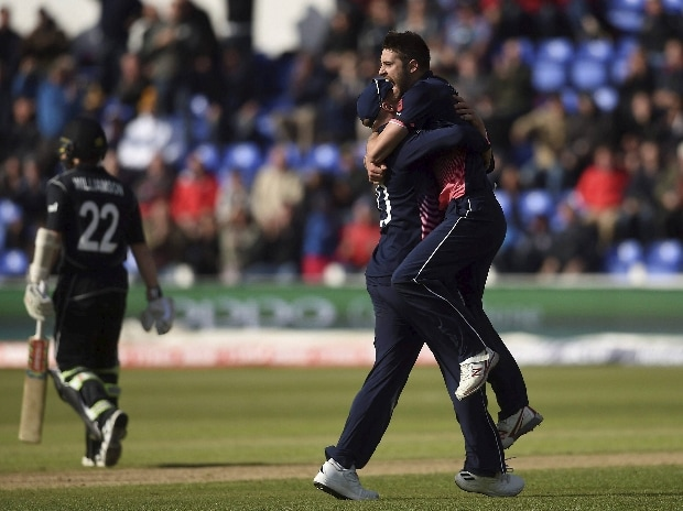 England's Mark Wood celebrates taking the wicket of New Zealand's Kane Williamson, left, during the ICC Champions Trophy, Group A cricket match between England and New Zealand in Cardiff, Wales. Photo: AP/PTI