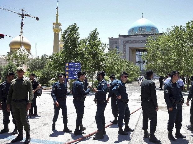 Police officers control the scene, around of shrine of late Iranian revolutionary founder Ayatollah Khomeini, after an assault of several attackers in Tehran, just outside Tehran, Iran.