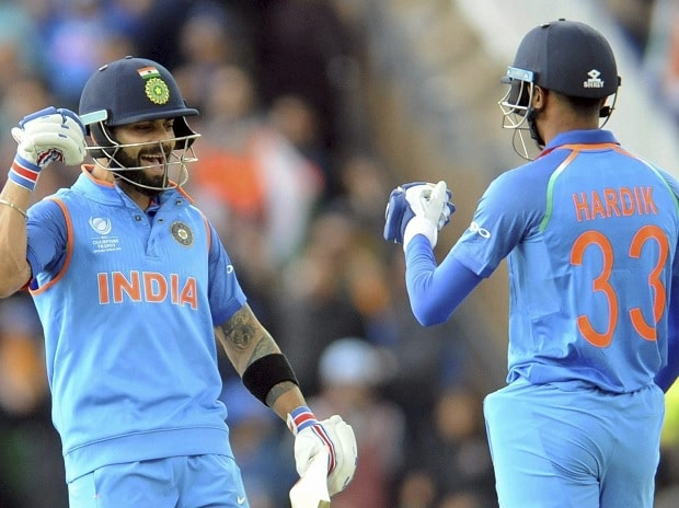 Indian cricket captain Virat Kohli and Hardik Pandya encourage each other during the ICC Champions Trophy match between India and Pakistan at Edgbaston in Birmingham, England, Sunday. Photo: PTI