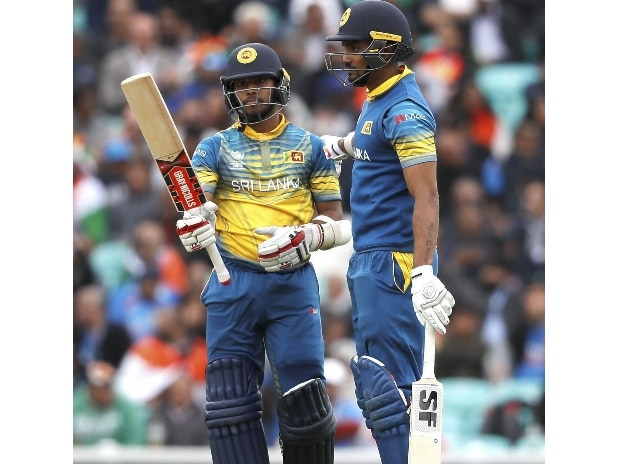 Sri Lanka's Kusal Mendis, left, celebrates getting 50 runs during the ICC Champions Trophy match between India and Sri Lanka at The Oval cricket ground in London. Photo: AP/PTI