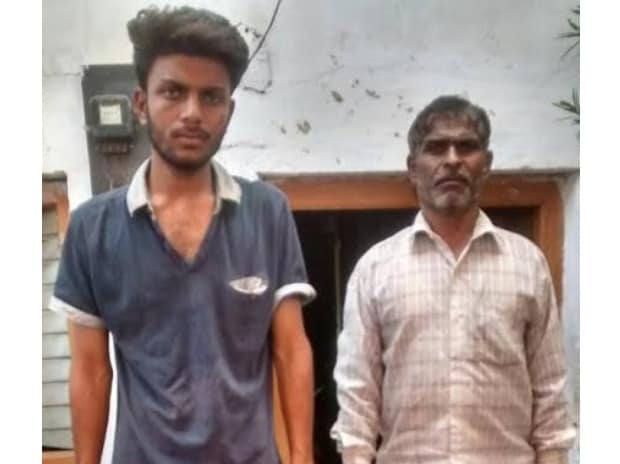 Dinesh Patidar (right), stands with his 17-year-old son Abhishek (left) whom he lost in police firing